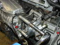 Now remove the three bolts securing the water pump to the end of the supercharger.