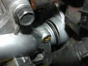 With a new o-ring fitted on the end of the pump, push the pump end into the flange on the engine block.