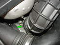 Remove the hose clamp securing the upper air hose to the throttle body and remove it.