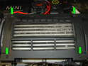 Remove the four T30 Torx bolts holding the plastic air diverter to the top of the intercooler (green arrows).