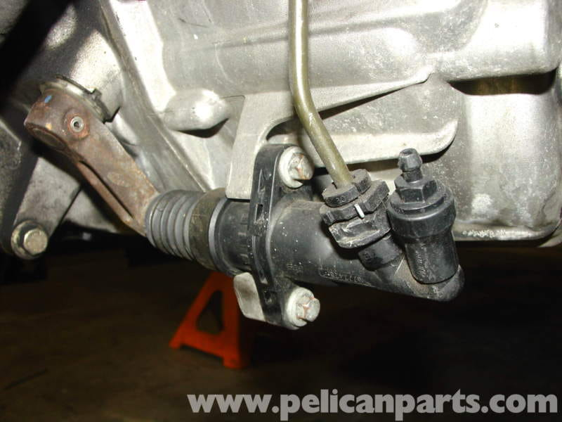 mini cooper clutch master and slave cylinder replacement r50 r52 remove the splash shield under the front of the engine and locate the clutch slave cylinder