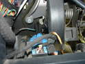 Next, remove the clutch safety switch from the side of the master cylinder.