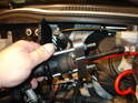 Here is the same steering wheel puller rigged up to compress the slave cylinder on the R50 MINI Cooper.