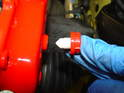 Remove the protective plug from the new caliper and throw it away, as you wont need it again.