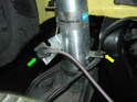 Press the grommets for both the brake line (green arrow) and the ABS sensor (yellow arrow) into the holders on the new strut.