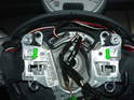 Take note of the two spring clips (green arrows) the airbag is secured to the wheel by these two clips.