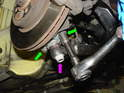 Place the new outer ball joint into the wheel housing and thread in and torque the two 13mm bolts to 56Nm (41ft/lbs.