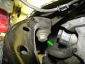 Now remove the two front bolts up underneath the struts on both sides (green arrow) NOTE: Driver's side is similar.