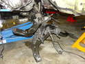 Here is a side view of the subframe being lowered.