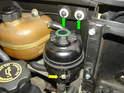 Above the engine compartment, you will see the power steering fluid reservoir.