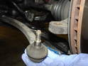 Next, remove the old tie rod end from the steering knuckle.