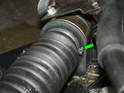 There is a large rubber boot covering the tie rod where it attaches to the steering rack inside the engine compartment.