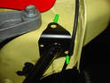 As with the passenger side, mark the two holes in the upper part of the strut, using the holes as a template (green arrows).