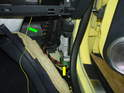 Now route the yellow/green wire behind the dashboard and over to the passenger side (green arrow).