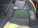Press down on the two tabs (green arrows) to remove the access cover on the right side of the trunk compartment.