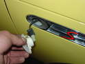 To replace the side turn indicators, push the lens assembly back towards the rear bumper and pull it out of the fender.