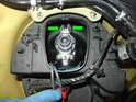 To remove the Xenon bulb, first turn the connector counterclockwise.