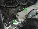 Loosen and remove the two 10mm bolts holding the airbox to the chassis (green arrows).