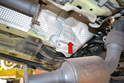 Use both a 10mm and 8mm socket to remove the piece of heat shield on the forward left side (red arrow); this will give you enough space to get the manifold through.