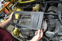 With the screws removed you can simply lift the cover off the intercooler.