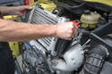 With all of the clamps disconnected you can simply lift the intercooler up and off the motor.