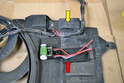 The resistor is located on the top right corner of the shroud (yellow arrow).