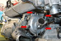 Use a 13mm socket and or wrench and remove the four bolts (red arrows) holding the supercharger to the water pump.