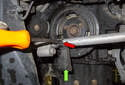 Using a flathead screwdriver, open the A/C line mount (red arrow).
