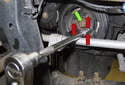 Do not remove the center crankshaft bolt (green arrow).