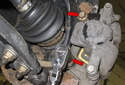 Working at the brake caliper-mounting bracket, remove the two 16mm caliper bolts (red arrows).