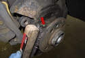 With the rotor removed, use a wire brush and clean the four exposed bolt threads (red arrow).