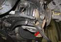 Lever the front ball joint away from the lower control arm (red arrows).