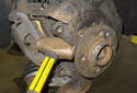 Next, remove the wheel bearing from the steering knuckle.