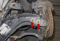 Remove the front ball joint 12mm fasteners (red arrows).
