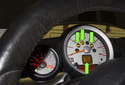 A faulty wheel speed sensor can set multiple brake warning lights (green arrows).