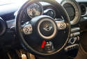 The MINI R56 steering wheel and steering column house a number of electrical and electronic controls.