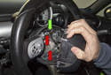 Pull the airbag off the steering wheel enough to access the electrical connectors.