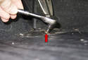 Then, remove the 4mm Allen fastener from the pedal assembly (red arrow).
