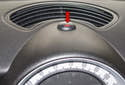 The hazard switch is located at the center of the instrument panel (red arrow) above the instrument cluster.