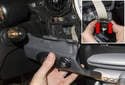 Pull the trim strip away from the instrument panel.