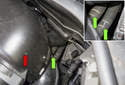 Working in the engine compartment below the intake air housing (red arrow), locate the heater hoses (green arrows).