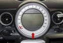 The instrument cluster (red arrow) on MINI R56 models incorporates multiple information gauges that display engine operation information, examples include: the fuel level, tire warning, navigation and vehicle speed.