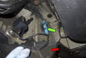 Rear sensor: Follow the sensor wiring to the body in front of the rear wheel well.