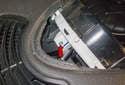 Next, remove the upper T20 Torx fastener (red arrow).