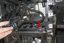 When installing, be careful not to kink or bend the fiber optic cables (red arrow).