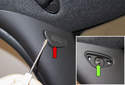A-pillar trim: Using a small flathead screwdriver, gently lever out the fastener trim cover (red arrow).