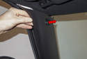 A-pillar trim: Pull the A-pillar trim panel away from the A-pillar (red arrow) while detaching it from the door seal.