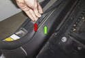Pull the door seal (red arrow) away from the trim near the rear corner of the door (green arrow).