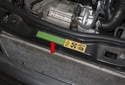 Use the label (red arrow) on the radiator support to confirm your vehicles charge amount.