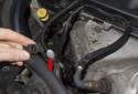 Evacuate, vacuum and charge the A/C system through the service port located at the right front of the engine.